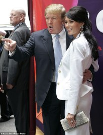 "FILE - In this Monday, May 17, 2004 file photo, Donald Trump, center, star of the television show ""The Apprentice,"" and his fiancee, Melania Knauss, right, arrive for NBC's presentation of its fall season to advertisers at Radio City Music Hall in New York. Randal Pinkett, who won the program in December 2005 and who has recently criticized Trump during his 2016 run for president, said he remembered the real estate mogul talking about which contestants he wanted to sleep with, even though Trump had married Melania, a former model, earlier that year: ""He was like 'Isn't she hot, check her out,' kind of gawking, something to the effect of 'I'd like to hit that.'"" (AP Photo/John Marshall Mantel)"