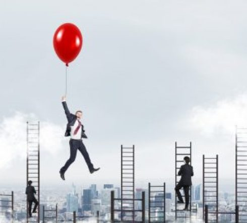 Businessman in a suit flying happily holding a balloon over Paris, men climbing ladders, concept of success and career growth / Copyright: ImageFlow