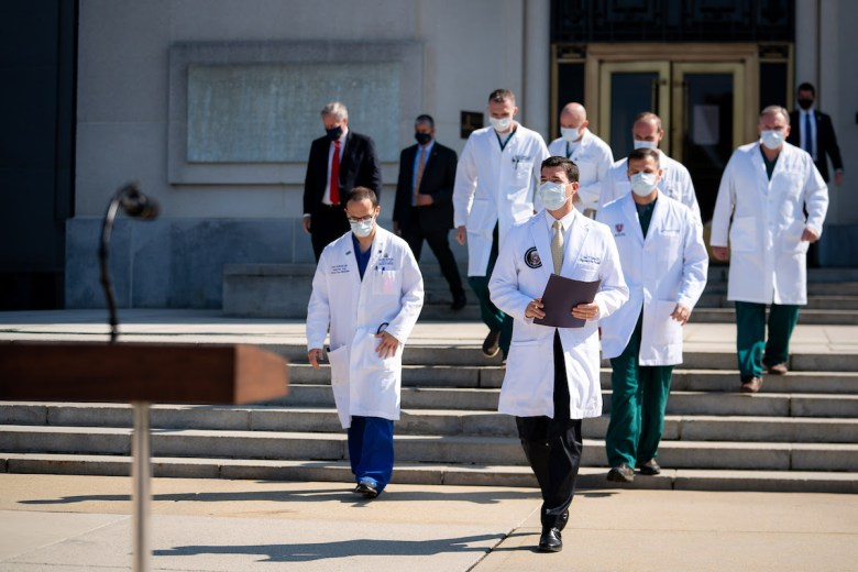 Physician to the President Dr. Sean Conley, joined by members of the President's medical team, arrives to deliver an update on the health of President Donald J. Trump to members of the press Sunday, Oct. 4, 2020, at Walter Reed National Military Medical Center in Bethesda, Md.  ( Photo by Tia Dufour)