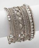 stacked silver braceltes