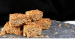 Easy Dairy Free Flapjacks. Soft, chewy flapjacks, full of oats and golden syrup. Just 4 ingredients, simple to make and perfect for lunchboxes or with your afternoon coffee. Soy Free, Nut Free and suitable for vegans too.