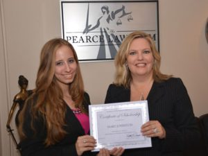 Edith Pearce awarding the 2014-2015 Pearce Law Firm Empowering Women in Law Scholarship to Mary Johnston.