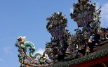 Intricate roof architecture with deities and dragon