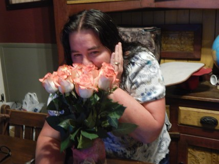 Ma and the lovely roses Dad got her. ♥