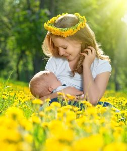 Woman breastfeeding baby outdoors