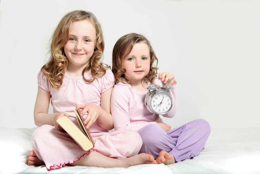 kids bedtime routine, story book and alarm clock.