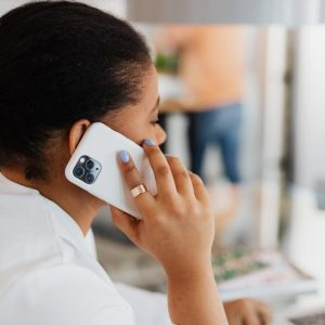woman in white top having a phone call