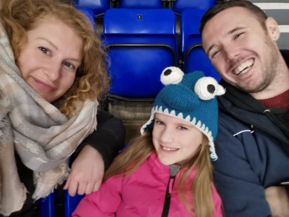 Smiling family at ice hockey game