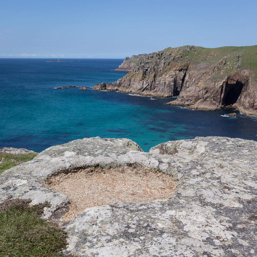 Carved bowls above Ardensawah cliff and Pendower Cove, Cornwall.