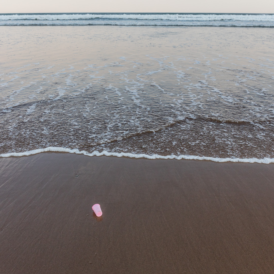 Pink cup at first light, Woolacombe Sand, Devon.