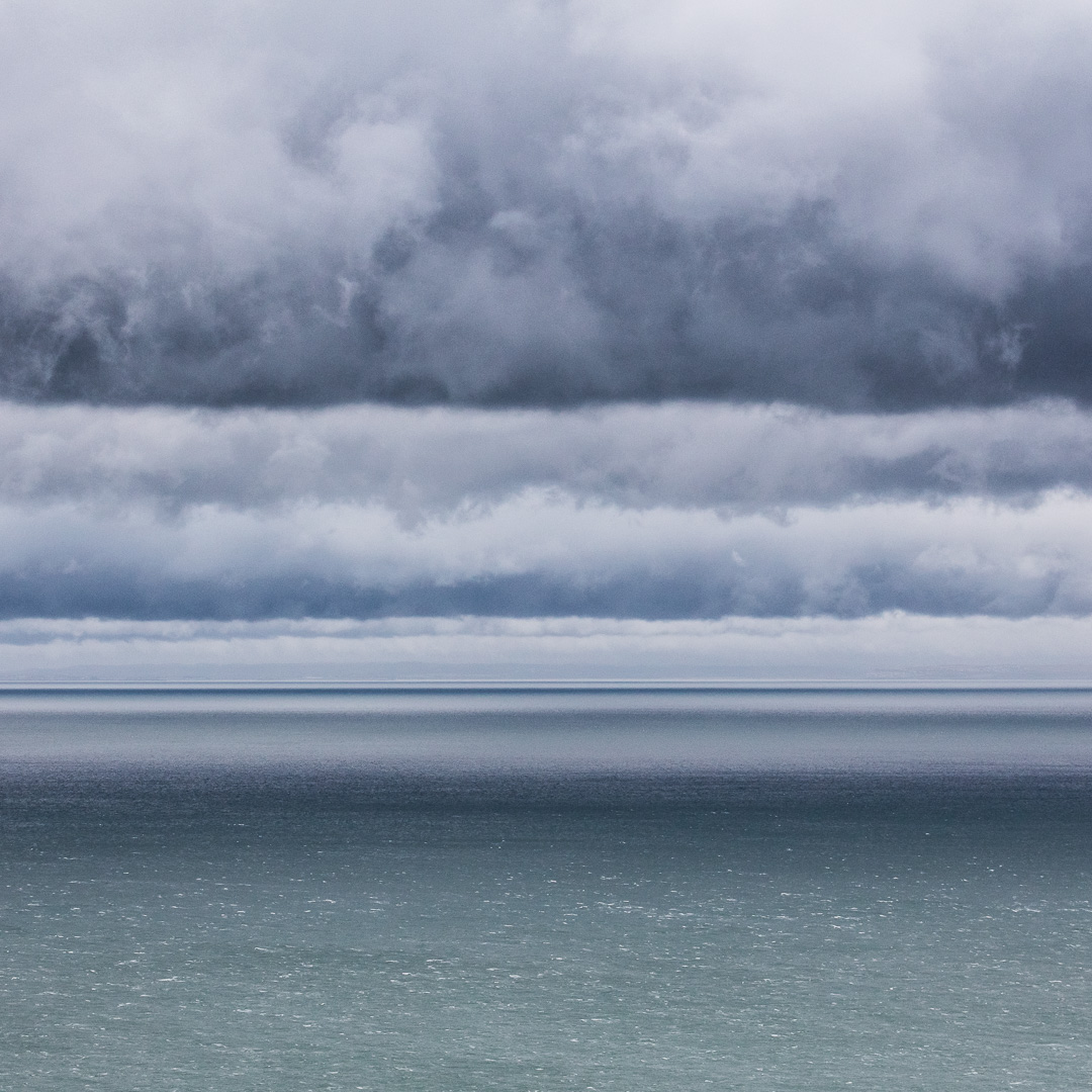 Banded clouds, glimpse of Wales from Somerset.