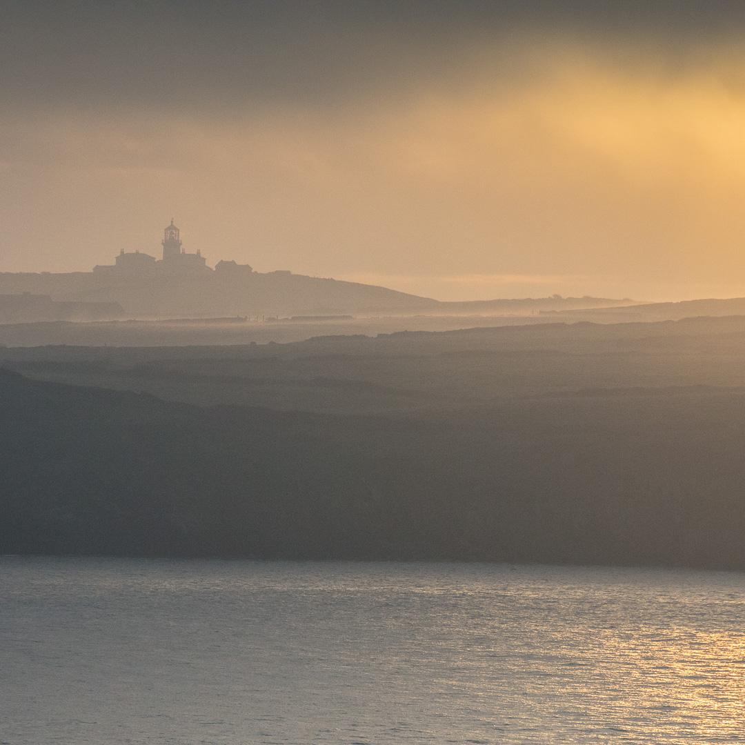 Sunrise over Caldey Island lighthouse, Dyfed.