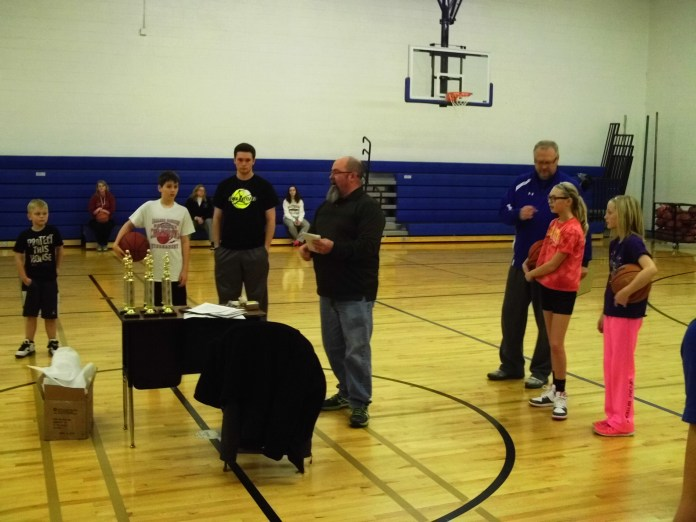 Perry Elk Mark McCarty, center, explains the ground rules to the young competitors in the 42nd annual Perry Elks Lodge Hoop Shoot.