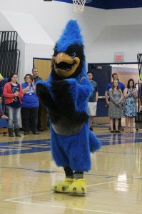 The Bluejay mascot helps fire up the crowd.