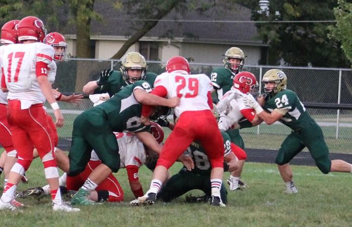 W-G defenders Joe Sturgeon (61) and Tanner Vermaas (28) stuff Central Decatur's Rayden Boswell at the line of scrimmage Sept. 23.