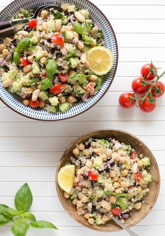 This vibrant vegan Quinoa Summer Salad is loaded with veggies and healthy beans, high in protein and naturally gluten-free. The perfect meal to enjoy on sunny days! Recipe from The Petite Cook