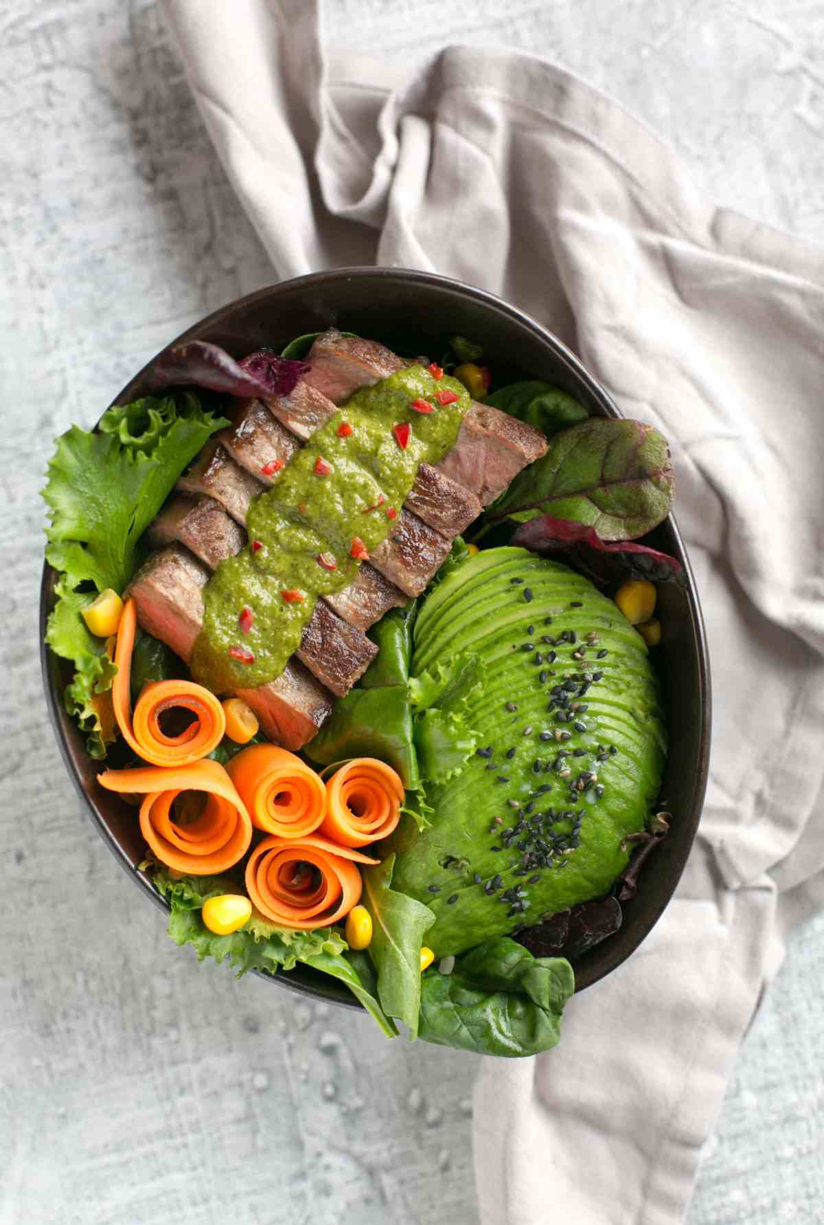 This vibrant Irish Steak Salad Bowl with Chimichurri Sauce is loaded with veggies, high in protein and naturally gluten-free. The perfect meal to enjoy all summer long! Recipe from The Petite Cook