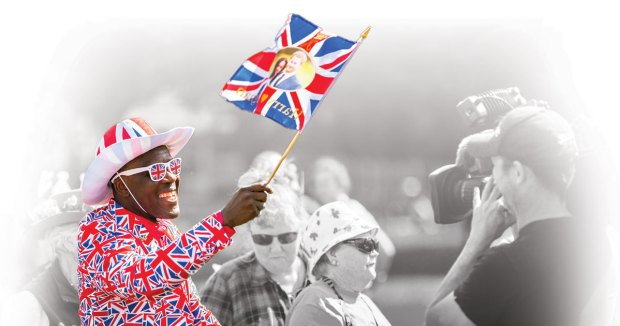man waiving england flag with royal couple