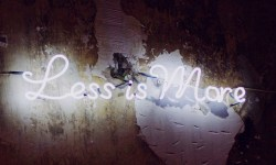 less is more neon sign