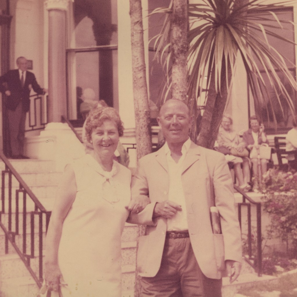 Photo of a couple which has become discoloured due to fading.