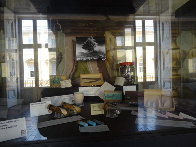Display case with reflections in the Palazzo Reale di Portici