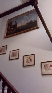 Hanging a 17th Century painting above stairs in a house in West Sussex