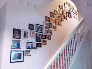 A collage or picture wall that I arranged and installed running up these stairs in Eastbourne, East Sussex.