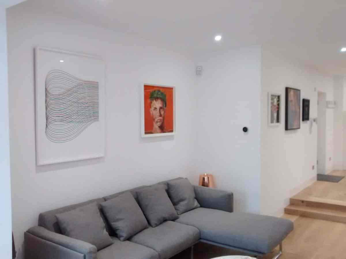 Arranging the pictures to define the separate spaces within this open-planned home.