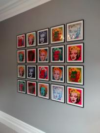 Picture wall ideas. A picture wall of twenty Andy Warhol prints, hung in a grid.