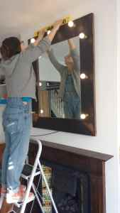 Installing a large illuminated mirror above a fireplace