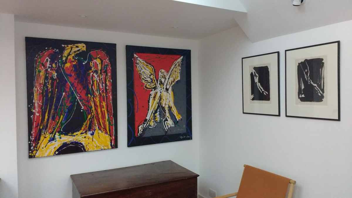 Lion and Eagle Acrylic paintings hung in purpose built alcove, with two male nude prints for company. A living room in Kemp Town, Brighton