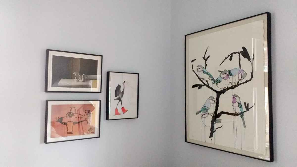 Fostering an appreciation of art. A picture wall hung in a kid's room in Hove.