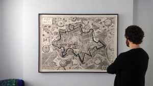 Patrick admiring artist Grayson Perry's Map of Days, hung in the master bedroom of a home in Brighton.