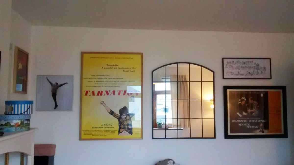 Album artwork and movie posters arranged in an electic mix on a guest bedroom in Saltdean.