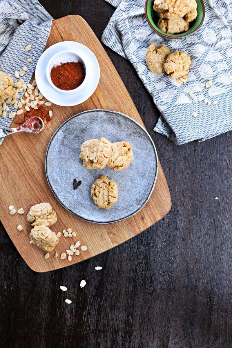 Super simple cheese crisps made with crisped rice cereal!! Great for cheese plates or party trays. Full recipe at www.thepigandquill.com. #partyfood #NYE #recipe #cheese #snacks
