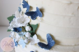navy-butterflies-wedding-cake