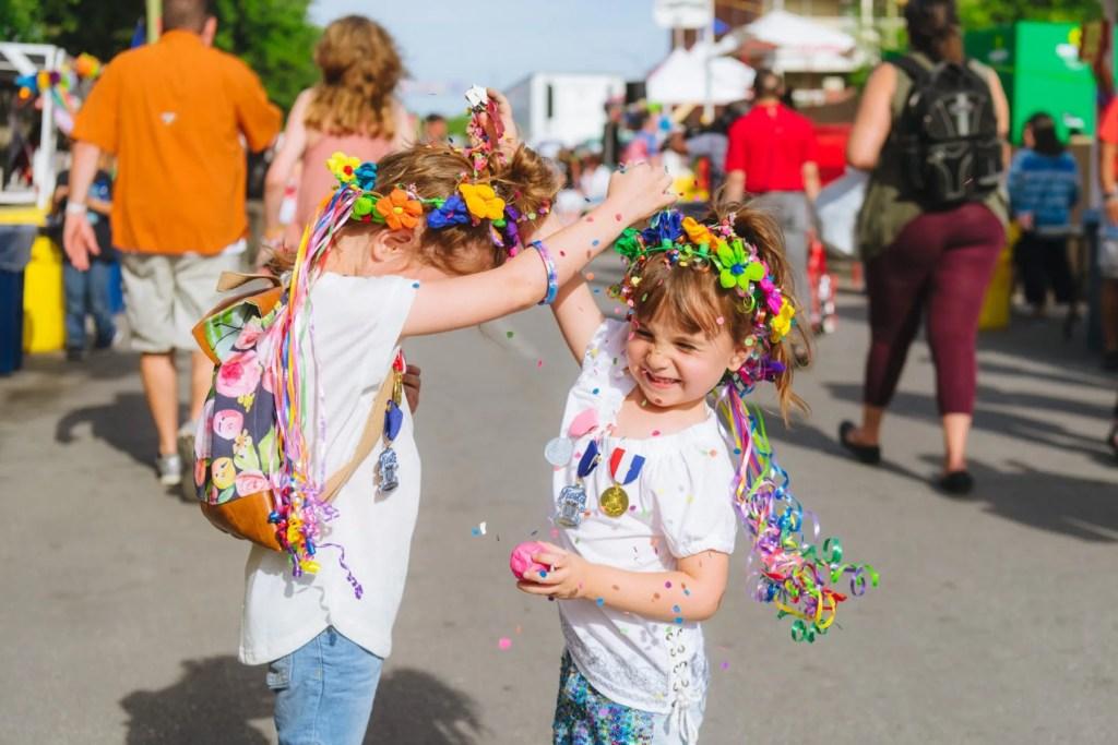 Breaking Cascarones on heads at Fiesta in San Antonio