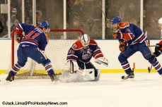 Condor Goalie Ben Scrivens covers a rebound as Matthew Ford (11) and David Musil (6) provide support