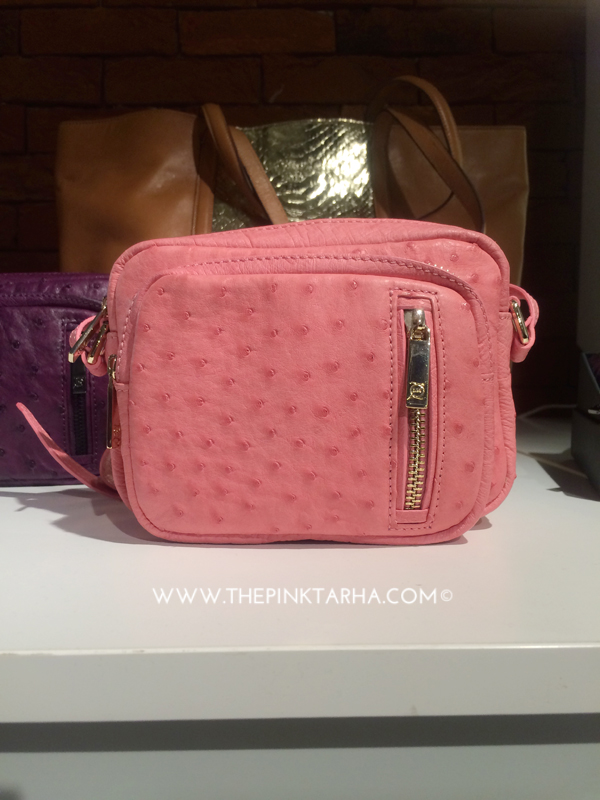 Pink ostrich messenger bag. Also available in other colors.