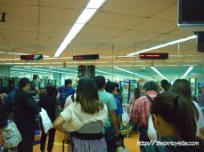 lining up before immigration naia 1 arrival