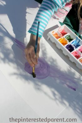 Painting shadows with watercolors - this is a wonderful art project that you can do with your kids while exploring shadow & light and nature