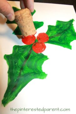 Cork stamped and painted holly. Winter and Christmas arts and crafts for kids and preschoolers. Cork stamping