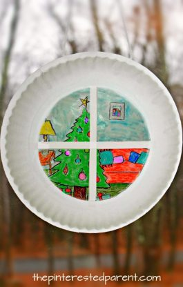 Paper plate sun catcher Christmas window scene. holiday and winter arts and crafts for the kids. Wax paper and SHarpies