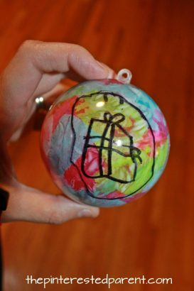 What would be better on your Christmas tree than a hand drawn ornament made by your child. Christmas and winter arts and crafts. Easy kid made ornaments with Sharpie and tissue paper..