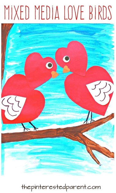 Mixed media heart shaped love birds for Valentine's Day. Watercolor, acrylic paint and construction paper and markers.