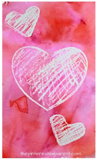 Crayon resist bleeding tissue paper painted hearts for Valentine's Day. Kid's arts and crafts ideas. Great for preschoolers