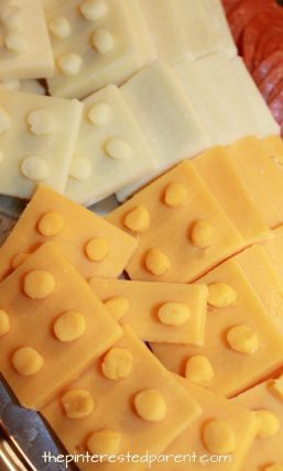 Lego cheese and cracker platter for a Lego themed party for the kids. Check out other food, decorations and activities. Party food recipe ideas.