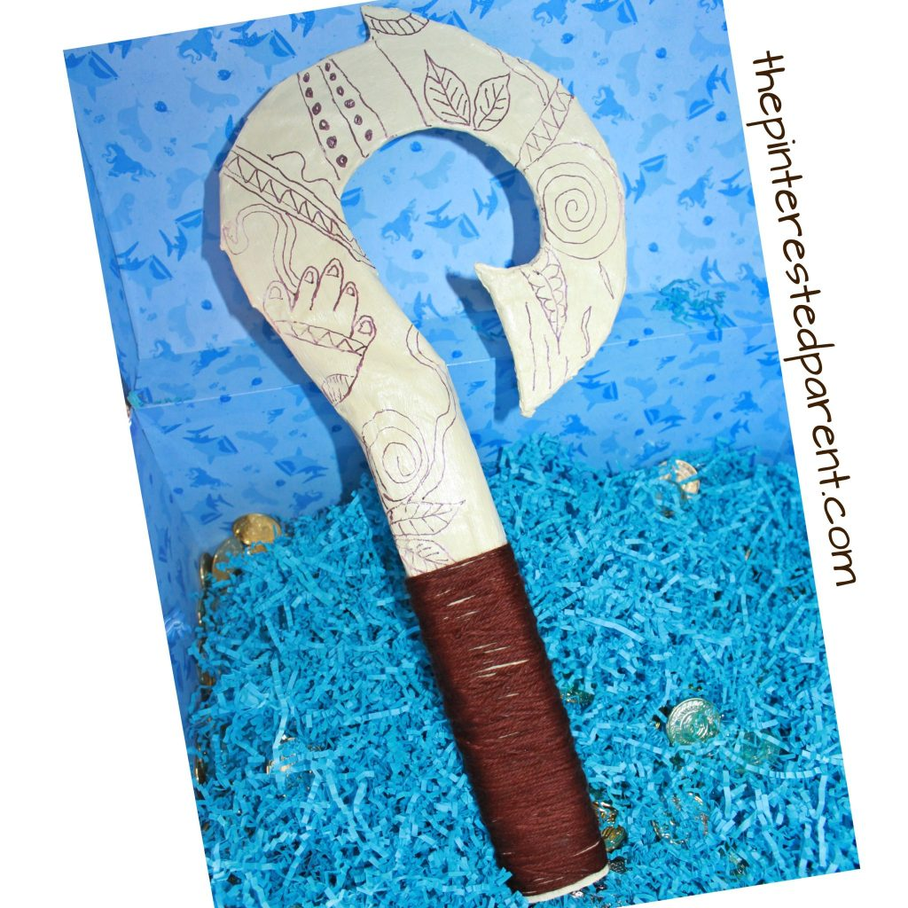 Moana inspired paper mache Maui fish hook. Use recyclables for a fun Disney inspired prop for pretend play. Kid's arts and crafts