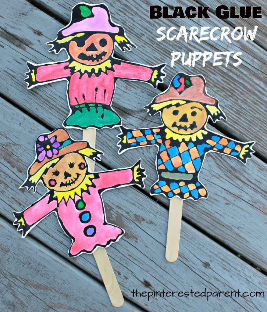 Black glue and watercolor scarecrow puppets with printable template to decorate. Fall / autumn arts and crafts for kids. Painting