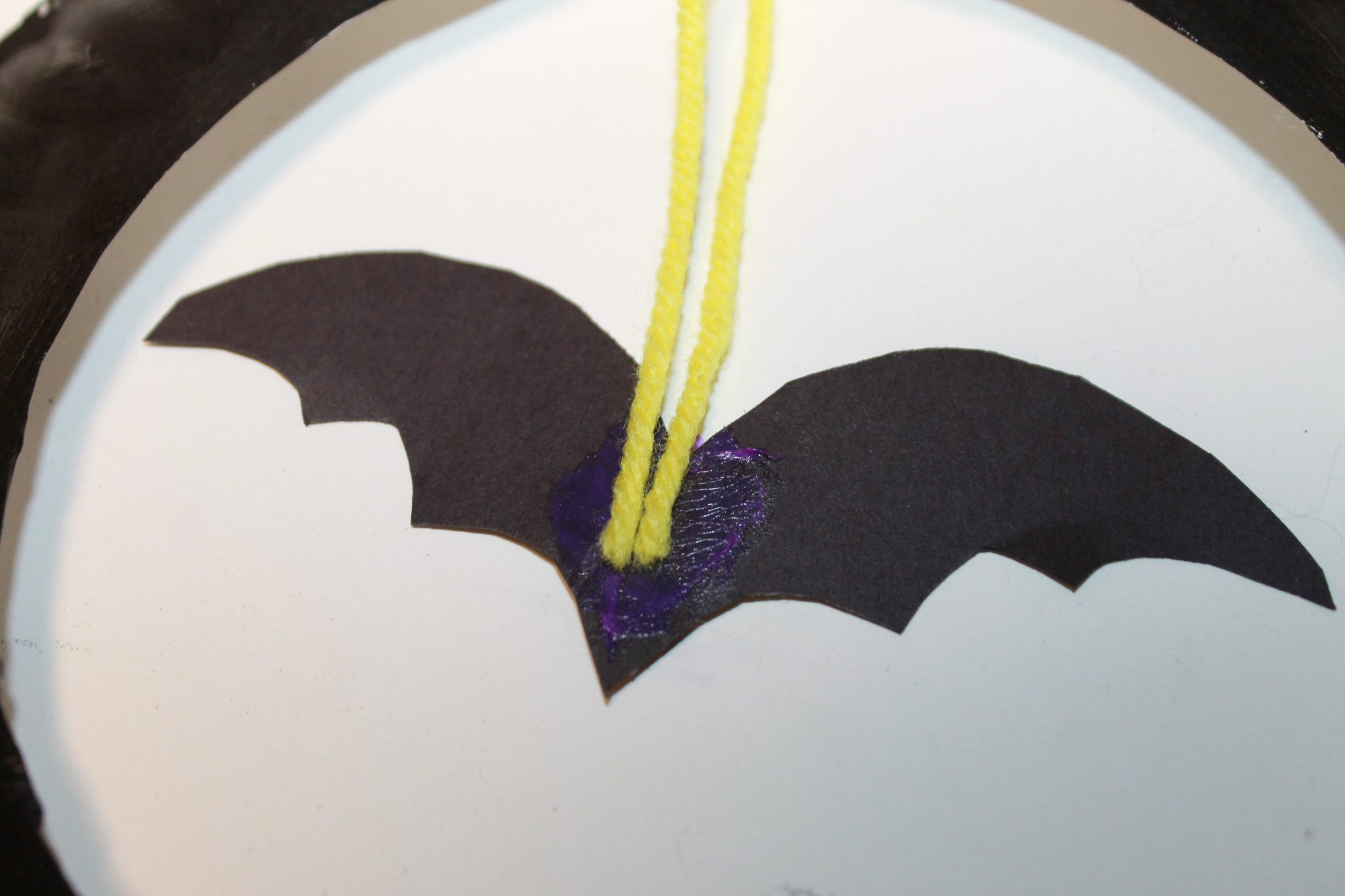 Flip the paper plate over and glue your wax paper tissue side up to the back of your painted paper plate. Glue the other paper plate over the top. & Flying Bats Sun Catcher Craft \u2013 The Pinterested Parent